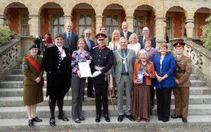 Volunteers and staff receiving the Queen's Award
